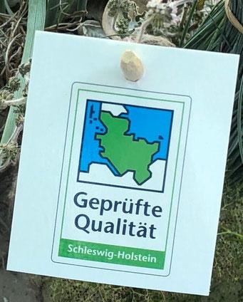 """Gütezeichen """"Geprüfte Qualität Schleswig-Holstein"""" für Zierpflanzen."""