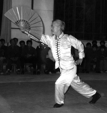 SIFU SHUM PERFORMING THE YING JOW FAN FORM IN BEJING, CHINA 1984