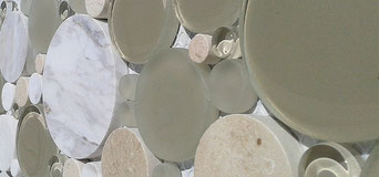 A beige and white glass and stone bubble mosaic