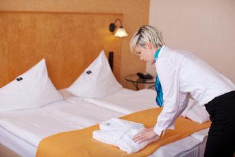 ホテルの仕事 - ベッドメイキング