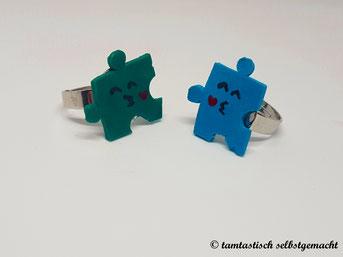 Ringe-Puzzleteile-mit-Küsschen-blaugrün-hellblau