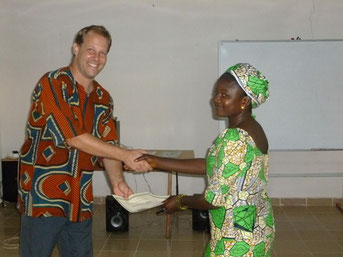 Eric awarding certificates at the graduation ceremony