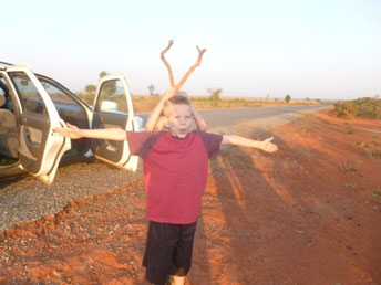 Roadside stop on our way to Abuja (Caleb helped with the antlers)