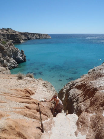 climbing Tsigrado beach, Milos, Cyclades, Greece.