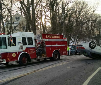 Engine 8 at the scene of a single vehicle MVA on Midway Ave