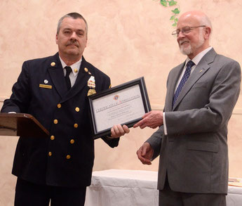 Asst Chief Zawodniak accepting the Shield Award from Grand Knight Seth McQuillan (photo courtesy Tom Kranz)