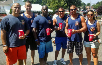 Pictured from left: FF Tony Grasso, FF Sam Fourre, FF Tim Green, FF Brian Piccola, Capt Kris Piccola, Brittany Plis