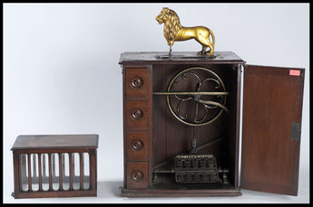 Metal and wood 'Lion' sewing machine, cabinet model made by Messrs Kimball & Morton Ltd, Glasgow, 1903