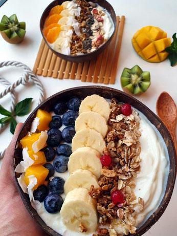 Yogurt bowl with mango, blue berries, banana's, granola, oats and dried cranberries!