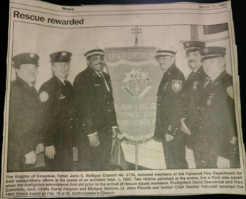 1993 photo and caption of Fanwood Firefighters receiving a reward for their actions from the Knights of Columbus.