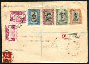 """21.12.1932 Port Morseby, R-Beleg mit FLP-Zusatzfrankatur von Niederl. Indien, per KLM via Batavia-Bangkok-Kairo bis Rom, rückseitig """"Roma Posta Aera"""" und Bahnpoststempel """"Roma-Pisa-Milano"""" vom 13.1.1933, weiter per Bahn bis Zürich."""
