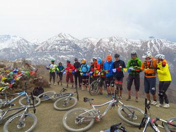 Mountain Bike Yoga Tour in Nepal, enjoying break with buddhist prayers and mountain view; Mountain Bike Yoga Vaccation in Nepal