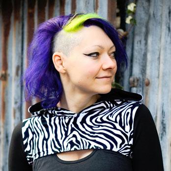 That's me, Janina, in a zebra print shrug