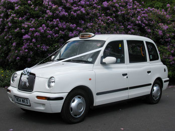 White Taxi Wedding Cars