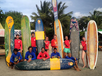 group surf lesson training at the beach