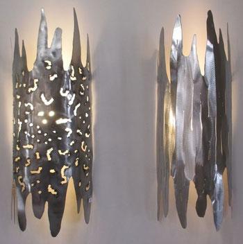 appliques inox à suspendre  travaillées à l'arc et au plasma, patinées ou meulées pièce unique  ambiance originale mur