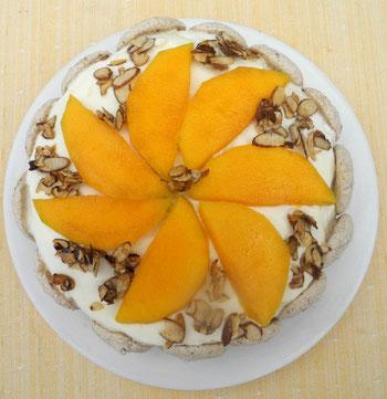 Sliced Mangos on a sponge cake