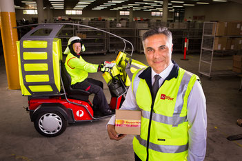 Australian Post CEO, Ahmed Fahour with e-vehicle