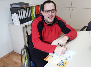 Andre Hoberg am Schreibtisch