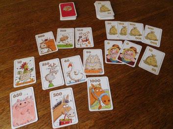 Spielmaterial von Kuhhandel: Tierquartette und Geldkarten