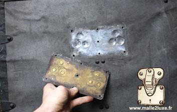 zinc and shiny brass vuitton trunk