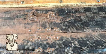 During the solvent stripping of a Louis Vuitton stenciled canvas