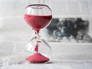 Hour glass showing time taking over raising stress levels. Giving time to de-stress