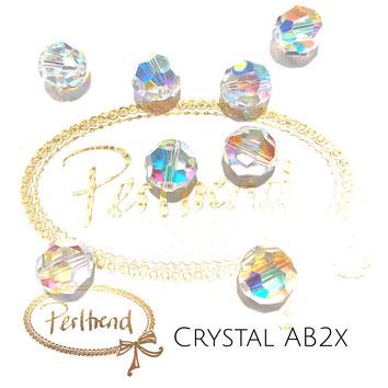 www.perltrend.com Perltrend Luzern Schweiz Onlineshop Perlen Schmuck Accessoires original Swarovski Crystals Crystal 5000 facet bead facettiert rund 10 mm Crystal AB 2x Aurore Boreale
