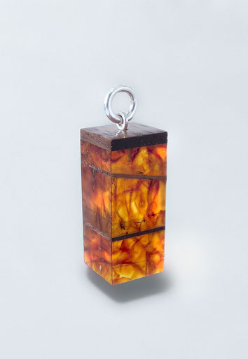 Formed amber, silver, wood