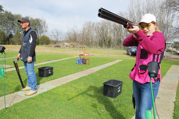 Hayley McCulloch next to her dad Shane preparing to shoot