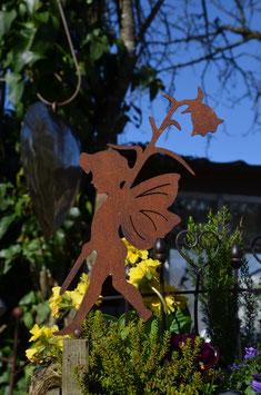 Laufender Elf mit Blume