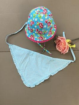 Vrolijk gekleurd hoedje en hoofddoekje voor baby