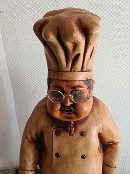 Koch mit Bratpfanne Werbefigur