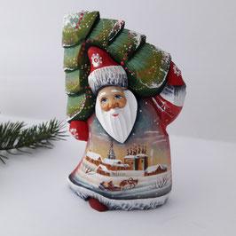 Weihnachtsmann mit dem Tannenbaum, Schlitten im Winterdorf