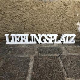 """Weißer Schriftzug """"Lieblingsplatz"""" aus Holz"""