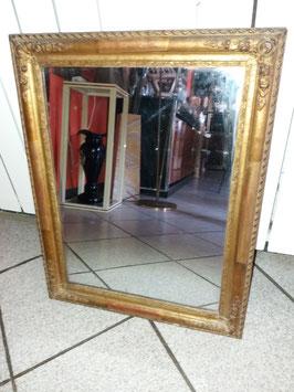 Ravissant miroir en bois et stuc doré à la feuille d'or