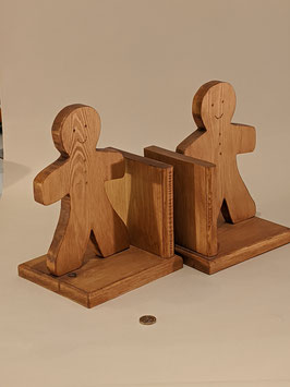 163. Delightful wooden Gingerbread person bookends.