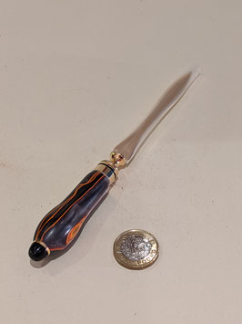 123. Stunning wood and gilt letter opener.