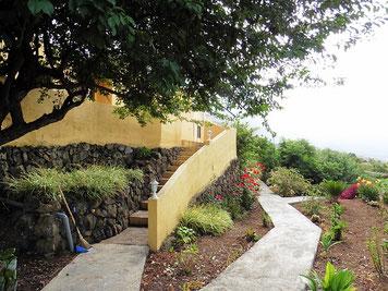 Zugang zu dem Haus und Garten