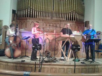 Backing Rick Thum (hammered dulcimer) at Nutmeg Dulcimer Festival. Carol Walker (bass), Sharon Grimshaw (fiddle), Sam Edelston (guitar).