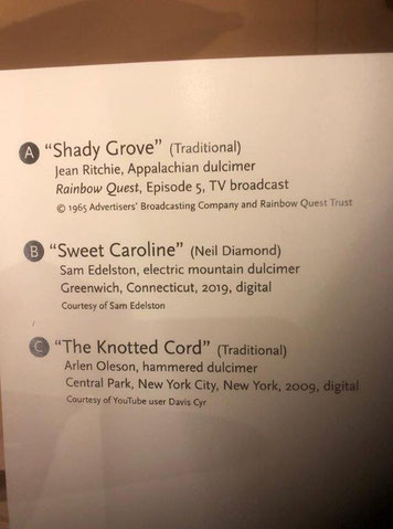 "Plaque next to video screen at the museum. Song A is ""Shady Grove"" performed by Jean Ritchie. Song B is ""Sweet Caroline"" performed by Sam Edelston."