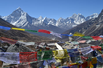Everest Base Camp Yoga Trek in Nepal, mountain panorama and prayer flags; Yoga Vaccation in Nepal, Yoga Trekking in Nepal