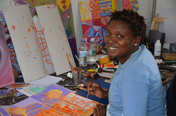 Zandile busy with her NALA artwork
