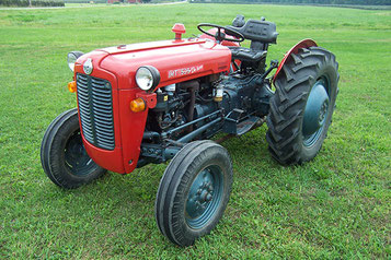 small used tractor with mowing attatchment and shovel
