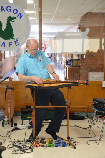 Photo Sam rocking the electric dulcimer at a school performance.