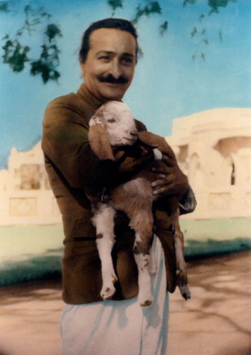 Meher Baba with kid goat in Alwar village, India - 1940. Colourized photo