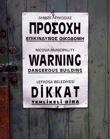 Tri-lingual Warning sign on one of the many unsafe buildings in the Old Town, Nicosia