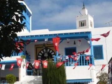 Frente al famoso café Des Nattes