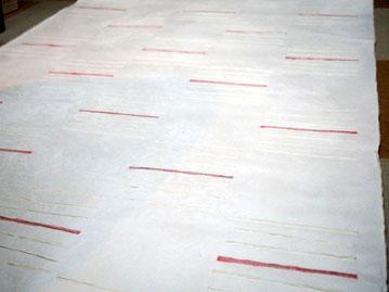 紙全面の市松模様に赤いラインが特徴の手漉き大判和紙