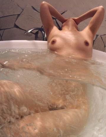 Nude figure in the water.